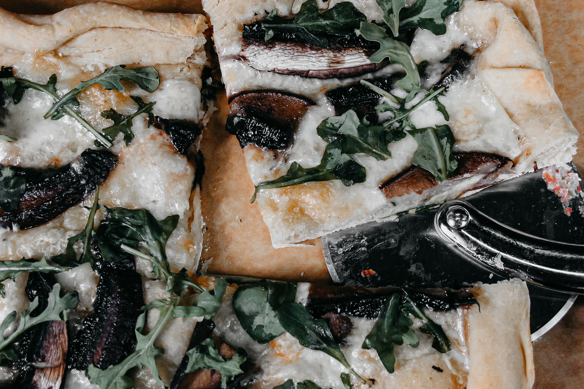 Bone Suckin' Talleggio and Arugula Pizza